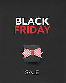 Gift Box with bow on black background and Black Friday Text