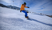 snowboarder snowboarding in winter mountains