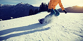 snowboarder snowboarding on winter mountain top