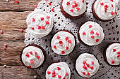 red velvet cupcakes decorated with hearts close-up. horizontal top view