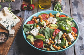 Healthy vegan salad with avocado ,beet leaves ,chickpea, broccoli ,tomato,blue cheese
