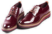 Deep red shiny pair of shoes