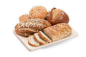 Various loaves of bread heap shot on white background