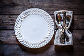 Vintage place setting shot from above on rustic wooden table