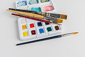 Box of watercolor paints and brushes