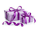 Two purple gift boxes with purple ribbons isolated on white background