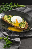 Healthy breakfast. Toast with avocado and egg