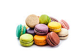 Several multi colored macaroons isolated on white background