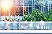 Big data , Iot , Internet of things every where , beacon and smart city technology concept. Neural networks connect signal graphic and blur group of people in metropolis.