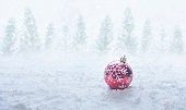 Christmas festival concepts ideas with red ball ornament on snow