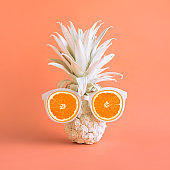 Summer holiday concepts with pineapple and sunglasses in pastel