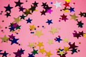 festive starry pink background