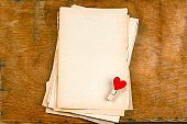 old empty paper sheets and cloth pins with hearts