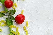 pasta set with tomatoes and basil
