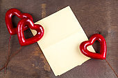 empty paper sheet and red hearts