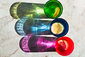 top view bright glass with drink and lemon slice, beautiful shadow on a stone marble table