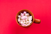 cup with marshmallows red background