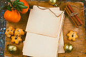 old empty paper sheets,cinnamon , star shape cookies  and tangerines