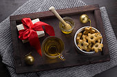 present with red bow, cookies in a shape of stars,tea cup  ,honey jar and golden christmas balls