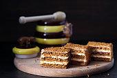 honey cake, slices of honey cake with butter cream