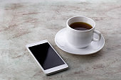 coffee cup and smartphone