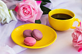yellow hot drink cup  and macaroons
