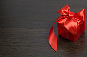 red gift box with red satin ribbon