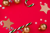 Christmas decoratins frame top view flat lay red background