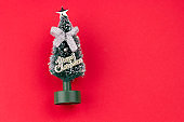 small decorative christmas tree red background