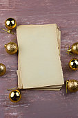 old empty paper sheets with christmas golden balls  top view