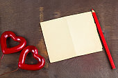 old grunge empty paper sheet and red hearts