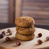 oatmeal cookies with hazelnuts wooden background