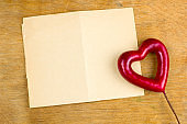 grunge empty paper sheet and red heart