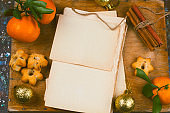 old empty paper sheets and tangerines top view
