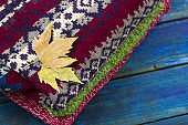 top view autumn leaves on a knited sweaters