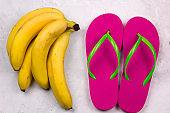 top view bananas and flip flops