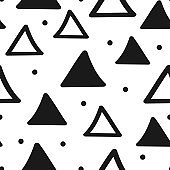 Seamless geometric pattern with triangles and round dots. Drawn by hand.