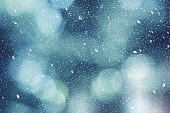 Blue Winter Outdoor Abstract Blurred Light Bokeh Nature Background Texture with White Falling Snow