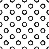 Ornament from circles painted with a rough brush. Seamless pattern with round shapes. Grunge, sketch.