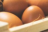 Brown eggs in wooden crate