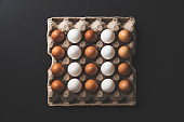 Box of eggs on black background