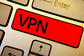 Text sign showing Vpn. Conceptual photo Secured virtual private network across confidential domain protected Keyboard brown keys yellow laptop idea create computer keypad laptop.