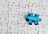 Safety, The inscription on the missing element of the puzzle.