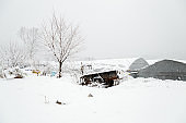 Snow covered rural farm village at Winter
