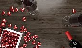 Red Wine Bottle And Two Wine Glasses With Opened Gift Box Full Of Red Hearts