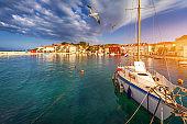 Fishing boat anchoring in beautiful Sutivan port, Brac island, Croatia. Sutivan on Island Brac in Croatia. Made of well known white limestone. Port with fishing boats. Sutivan, Brac, Croatia.