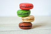 Colorful macaroons or macaron on a white wooden background.Isolated. French delicious pastry.