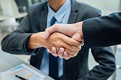Concept of partnership - handshake business partners Successful team leader entrepreneurship
