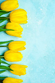 Celebrate background with bouquet of yellow tulips