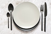 Black and white tableware on marble